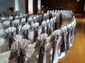 White chair covers with grey and white lace chair sashs