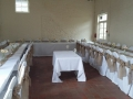 White chair covers with hessian sash at Court Gardens in Ditchling