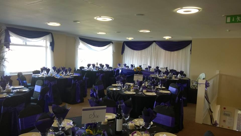 Black chair covers with purple sash