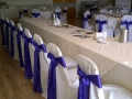 Ivory chair covers with purple sash