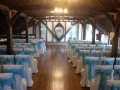 White chair covers with soft blue sash at Blackstock Barn