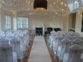 Chair covers and silver sashs at Gildredge Manor