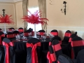 Black chair covers with red sash for vegas theme wedding