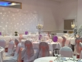 Coral sashs on white chair covers at Jurys Inn, Brighton