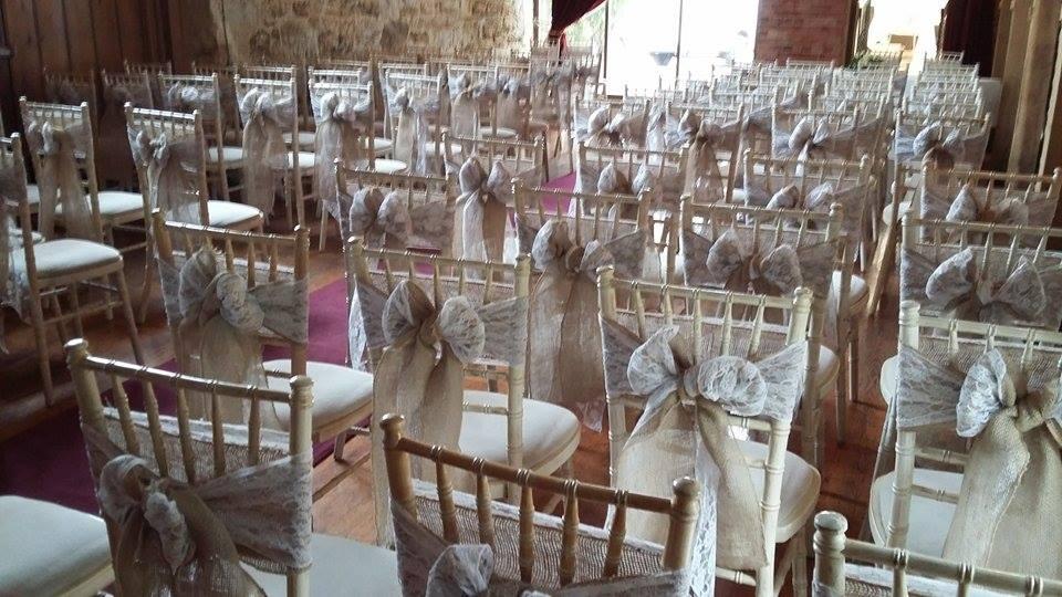 Double hessian and lace sashs on limewash chivari chairs
