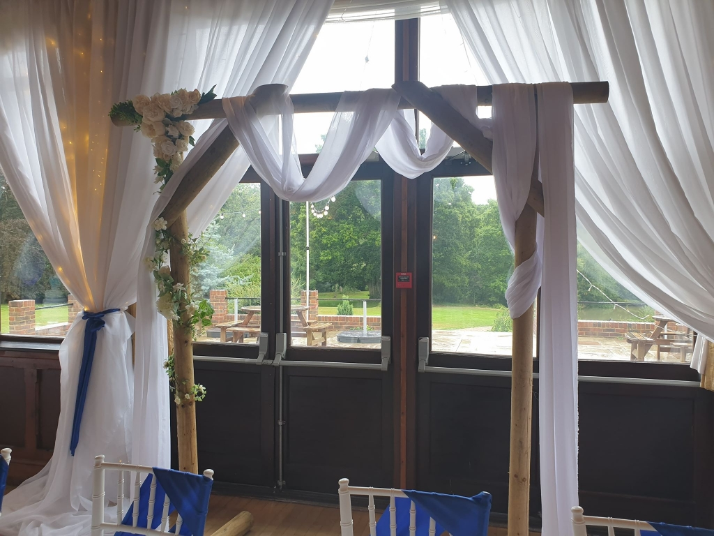 Window drapes and woodland backrdrop