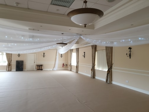 White drapes and cream carpet at Deans Place