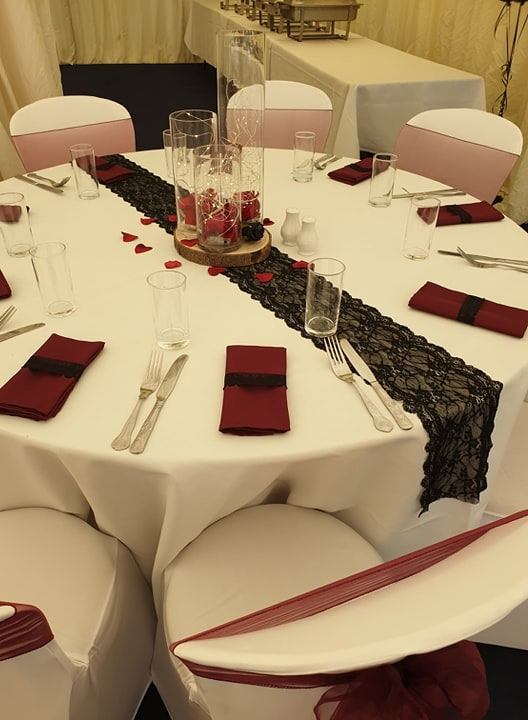 Burgandy Napkins and black lace runners